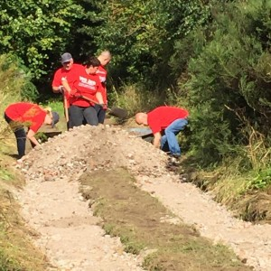 Santander UK Team creating a path in Willowbank Wood